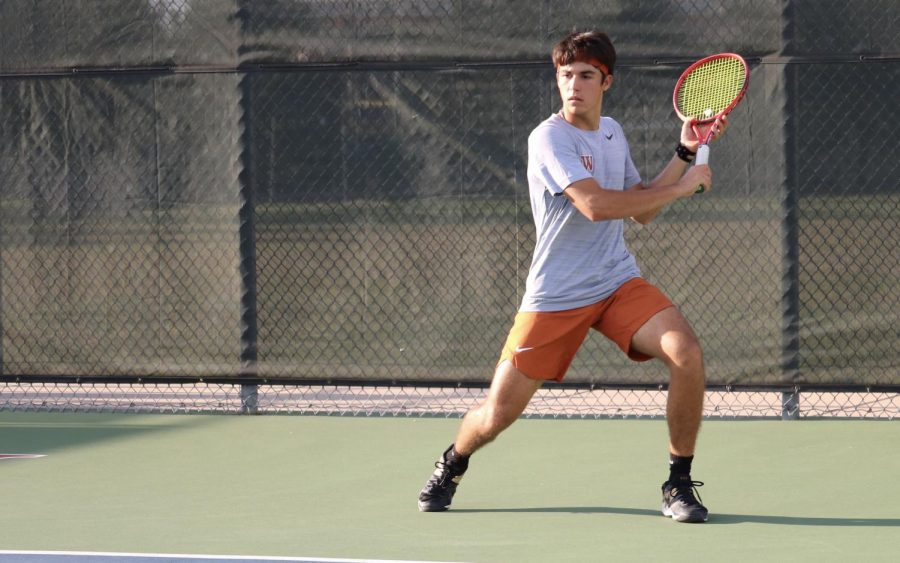 Marko Mesarovic '23 sets his feet in preparation for a wide slice return, pulling his opponent off the court and winning the point. He would win his singles match 6-1, 6-0.