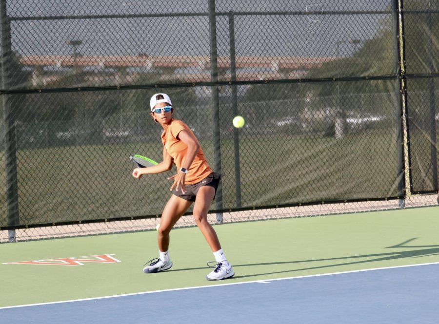 Simryn Jacob '24 lays her racket back for an inside-out forehand return to the other side of the court. She would win this match 6-2, 6-0.