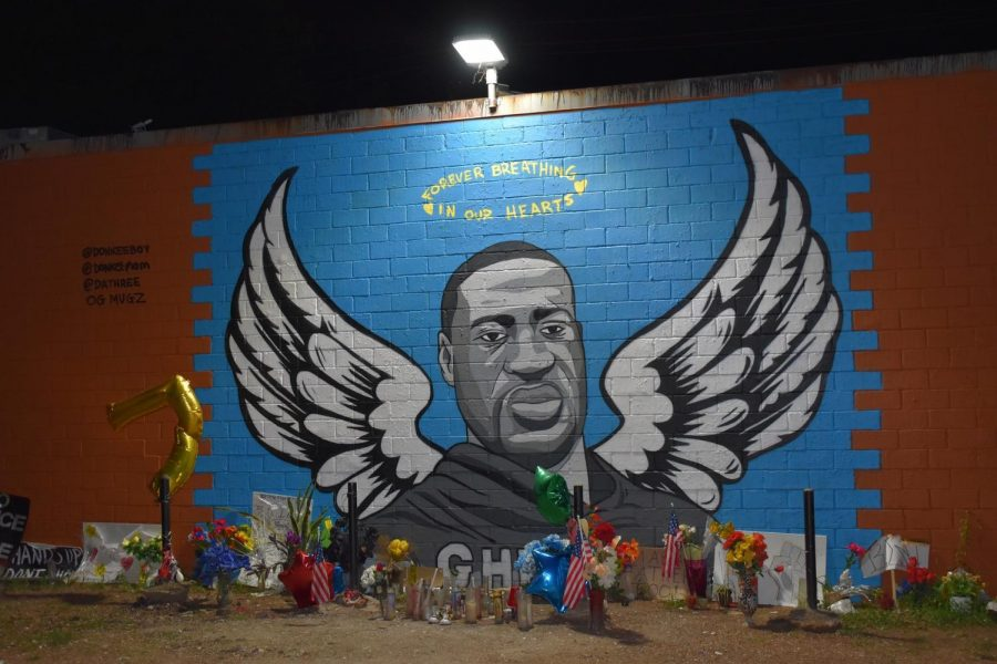A George Floyd mural is created in Houston to commemorate the loss of his life.