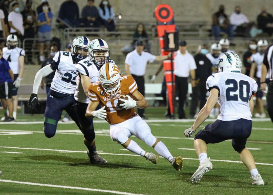 With a defender right behind him, Robbie Jeng '21 slides to a stop against McNeil. With 254 yards receiving against Hutto, Jeng broke the school record for most receiving yards in a game on Wednesday, Nov. 25.