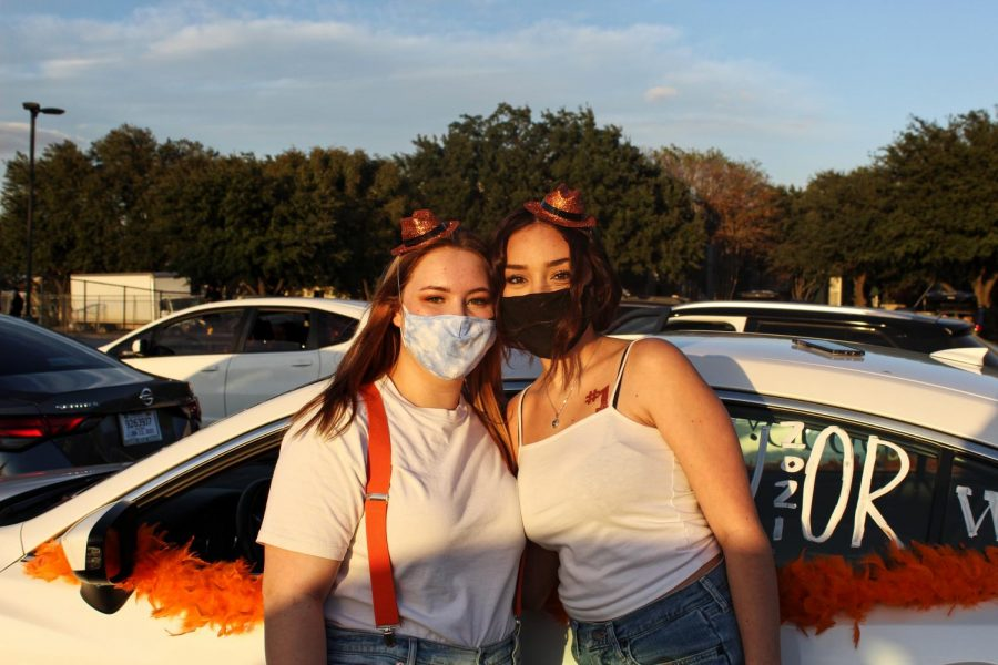 Balei Lonnotti '23 and Emilie Smith '23 pose in front of their car at the pep rally. After this, they won a Panda Express gift card for having the best decorated car.