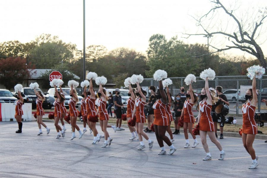 The cheerleaders perform a combo. They stayed the whole event, cheering and dancing.