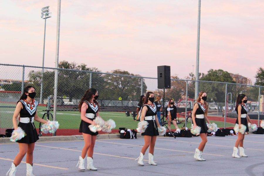 The SunDancers perform a dance number. They performed twice, once in the football field and also once in the parking lot.