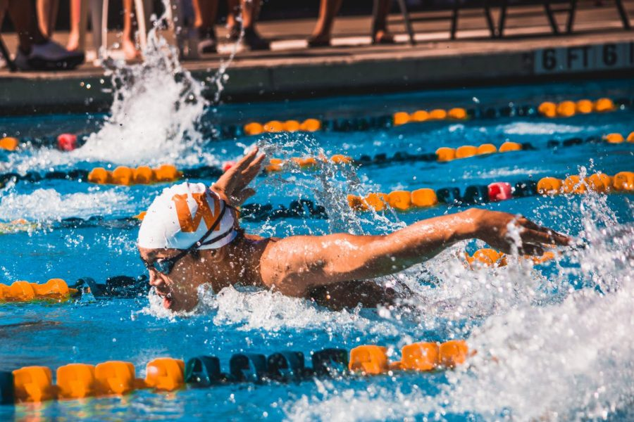 Racing to the wall, Joshua Kang '21 finished his 100 yard fly with a time of 57.49. This time granted him 6th place overall.