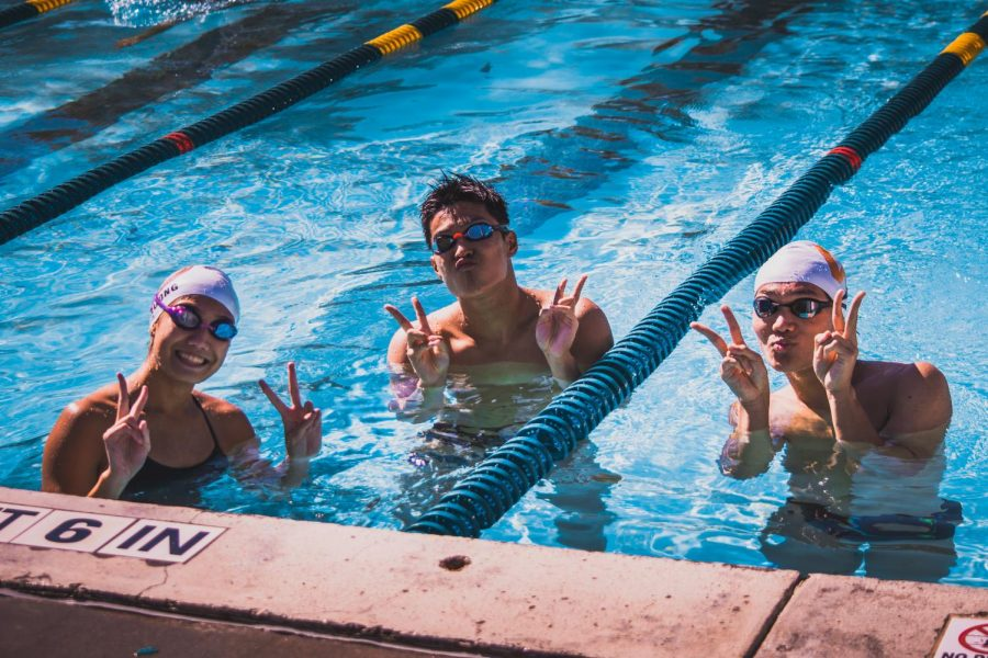 KyAnh Truong '21, Benjamin He '23 and Joshua Kang '21 relax in the warm down pool during a break.