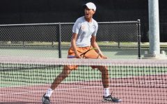 Erupting in celebration after an aggressive volley shot, Aashish Dhanani '22 wins the point with partner Jessica Lu '21 in mixed doubles. They'd go on to secure a commanding victory of 6-1, 6-3.