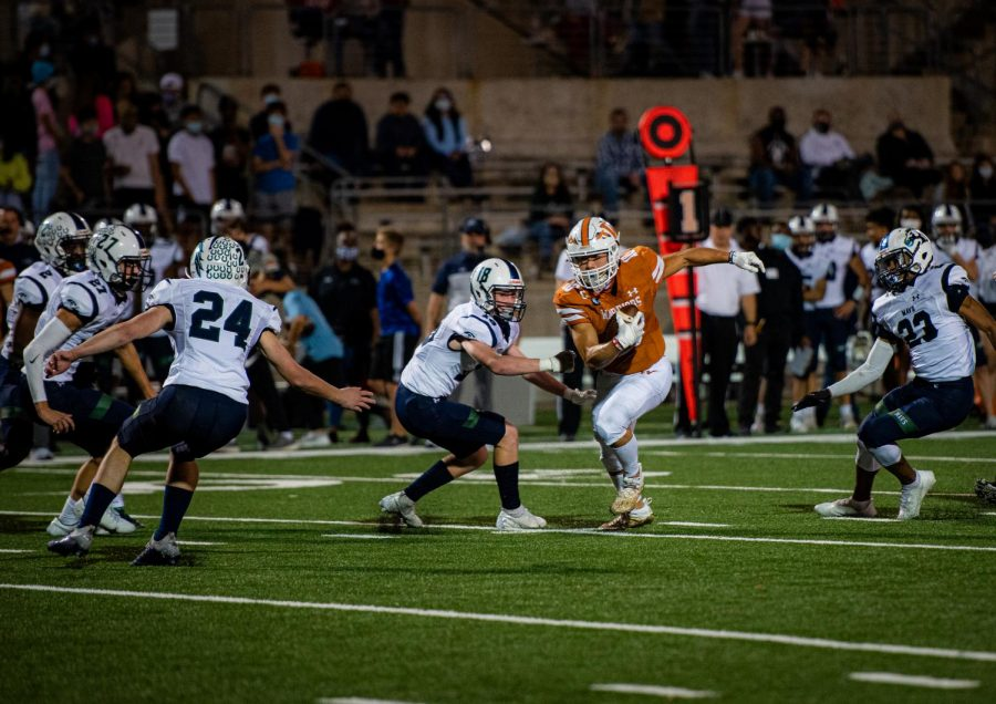 Surrounded by McNeil defenders, wide receiver Robbie Jeng '21 turns upfield after picking up a first down. Despite Jeng's record-breaking performance against Hutto the following week, the Warriors fell to the visiting Hippos, eliminating them from playoff contention.