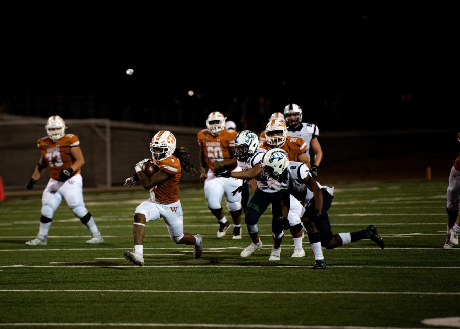 With the defensive line chasing them, Nate Anderson '21 zooms towards the touchdown line. The play occurred right after the third quarter where the Warriors were able to snatch a significant lead on the Mavs.