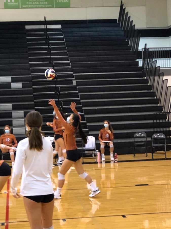 Rachel Cai '24 prepares to hit the ball. Since it didn't go too far, the opponent team also attacked it. Vandegrift won this point.