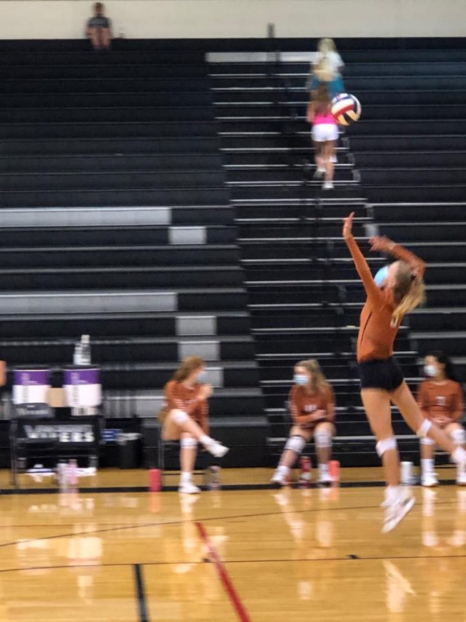 Claire DeLane '23 prepares to spike the ball. Despite her best efforts, Vandegrift ended up winning the point.
