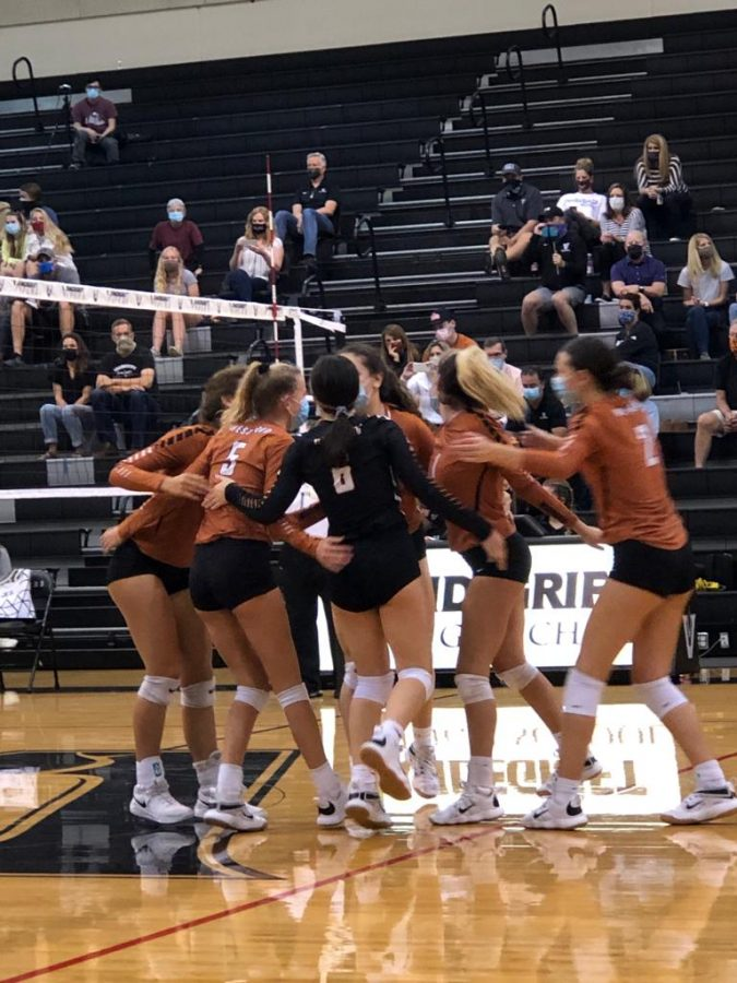 The Westwood orange jv team calls in for a quick team huddle to boost motivation after winning a point. The team took down Vandegrift 25-23.