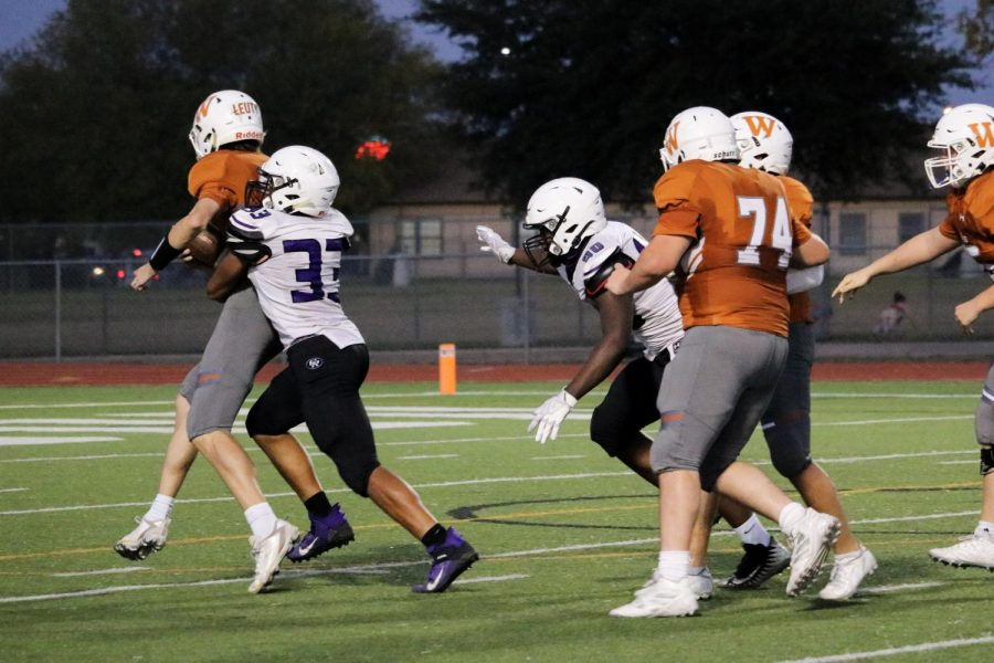 Quarterback Michael Leuty '23 gets sacked by a Cedar Ridge defender causing him to lose several yards. This was a 15-yard loss.