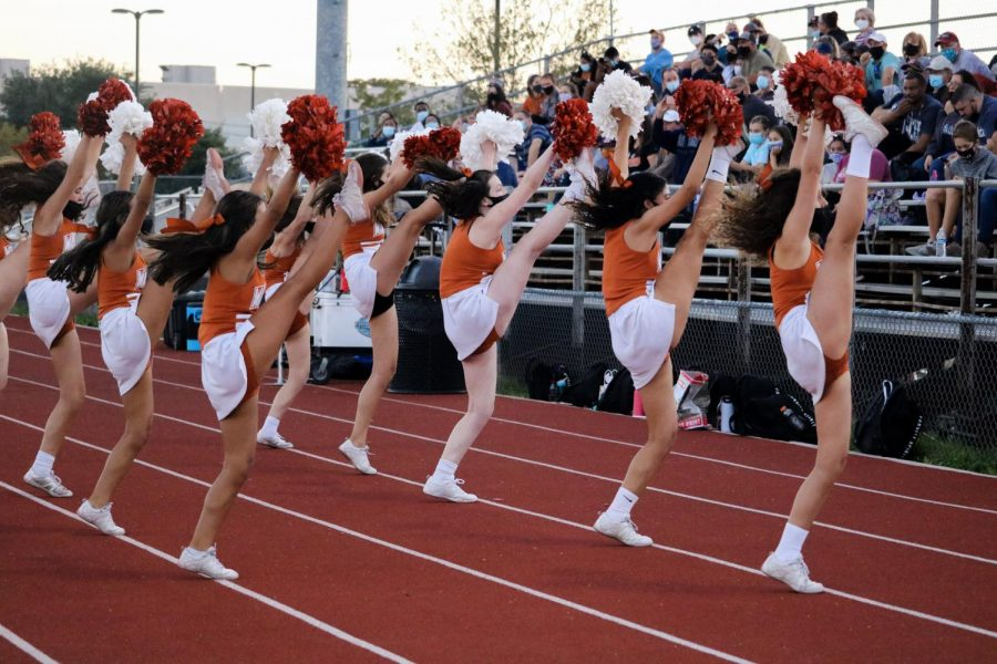 The JV Cheerleaders cheer on the Warriors from the sidelines. After many practices, they came up with several cheers.