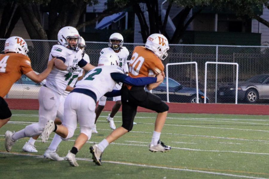 The running back gets tackled by the Maverick defense. He went for a 10-yard gain.