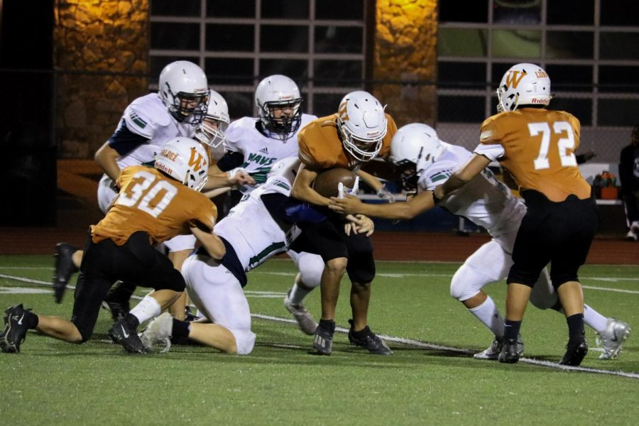 The Maverick defense stops the Warrior running back. They were short of their first down.