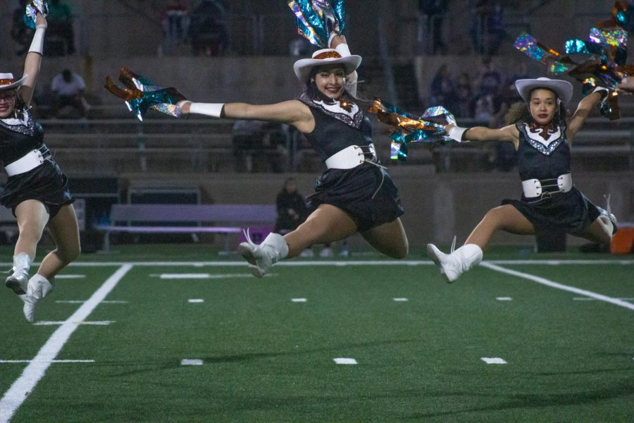 During the halftime show, Faye Merritt '23 leaps into the air. The Sundancers performed to Confident by Demi Lovato.
