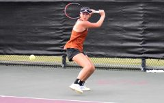 Advancing inwards on the ball, Jessica Lu '21 maneuvers her racket face in preparation to hit a short trajectory backhand slice shot. Lu is one of six tennis players to advance to the State tournament later this month.