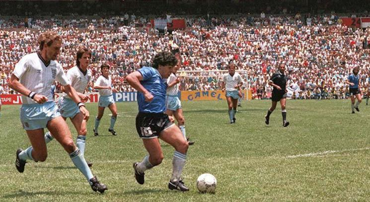Diego Maradona dribbles past England defenders in the 1986 World Cup. Maradona, who passed away on Wednesday, was widely considered as one of the greatest soccer players of all time. Photo courtesy of Wikimedia Commons.