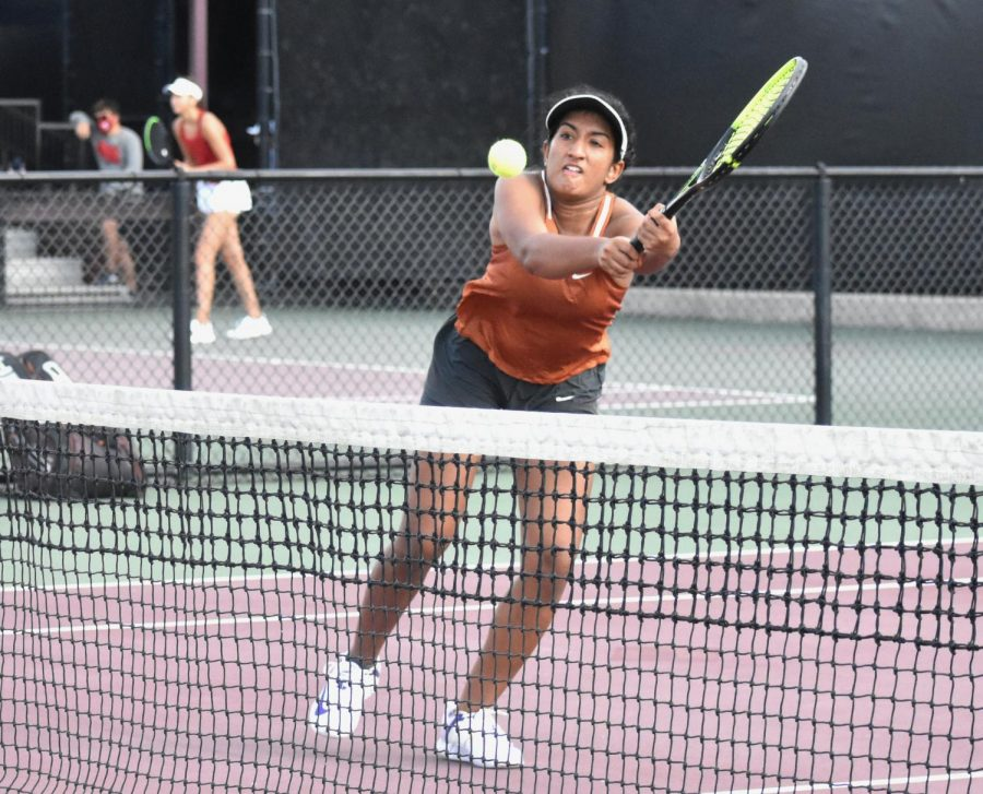 Lunging across the net, Rishika Vemulapalli '22 extends forward to put away the volley shot. Partnering with Alex Mepham '24, the duo fought hard against their opponents, but ultimately lost 5-7, 1-6.