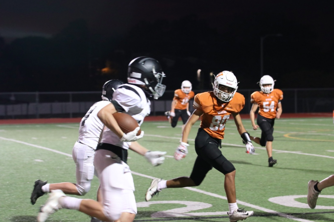 Wide receiver Ace Rodriguez '23 chases after an opponent who caught a fumble. He was able to stop him a few yards before the goal line.