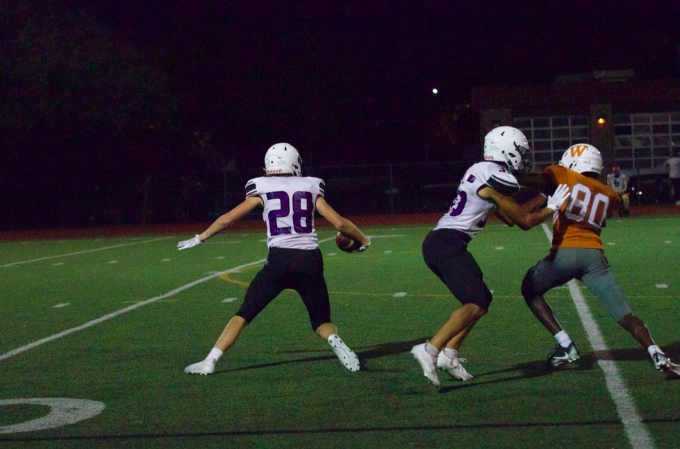 Shaun Moukam '22 attempts to go around the defender and stop the opponent's pass. He is unable to do this causing the other team to gain yardage.