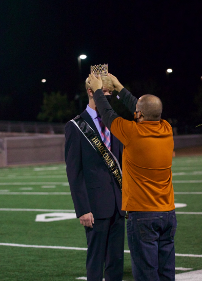 Principal Dr. Acosta crowns Hart Black '21 after winning homecoming royalty. The homecoming half time included a performance from the Sundancers as well as a introduction of all of the homecoming nominees.