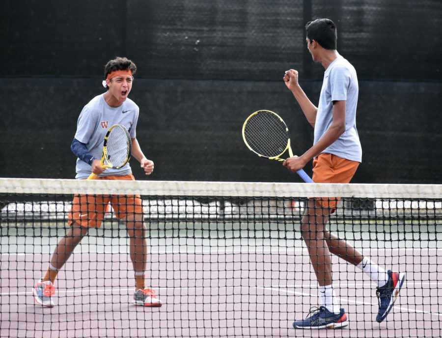 Turning to face each other in joy, Zeyad Elchouemi '22 and Sachchit Sivaram '21 break out in excitement over an impressive display of teamwork that would widen the lead over their opponents. Working together as partners since 2018, Elchouemi and Sivaram have learned to find a rhythm in their collective styles of play.