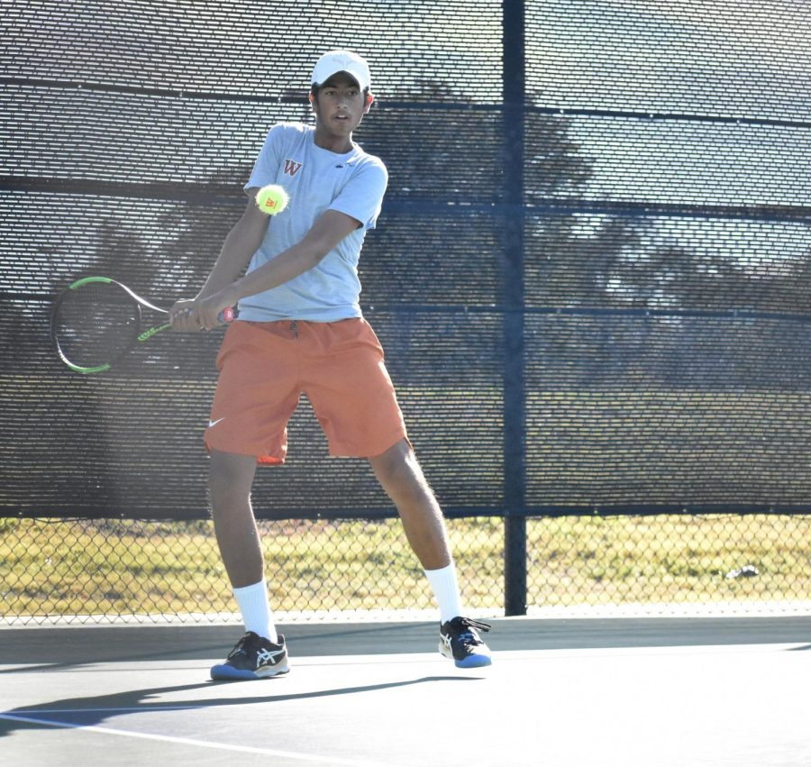 Dropping his racket back, Aashish Dhanani '22 prepares to send a backhand return over the net. He would go on to win his match 6-2, 6-1.