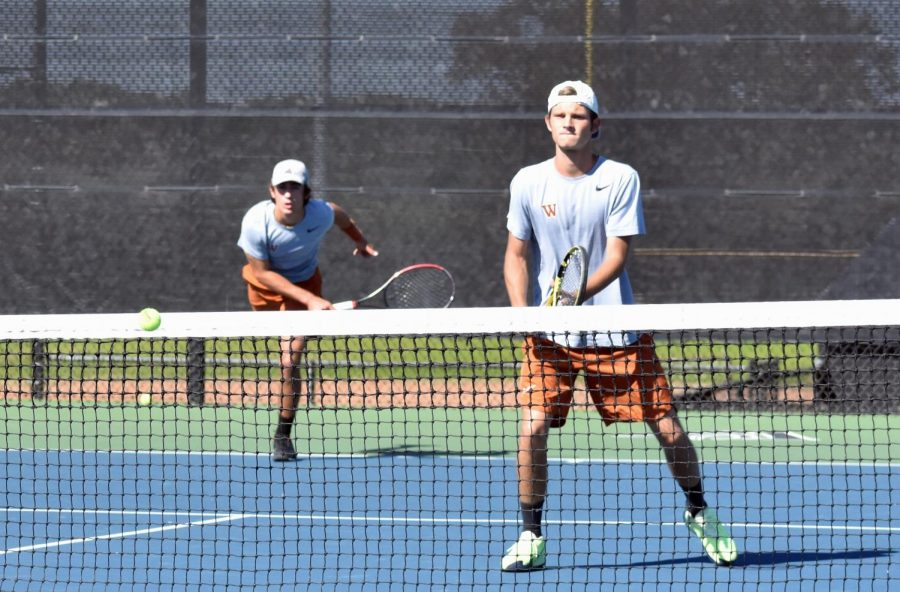 Following through on a serve to his opponents, Daniel Antov '21 and his partner Nic Pesoli '21 look onwards, anticipating the ball's trajectory. Antov and Pesoli prevailed with a 6-3, 6-0 win.