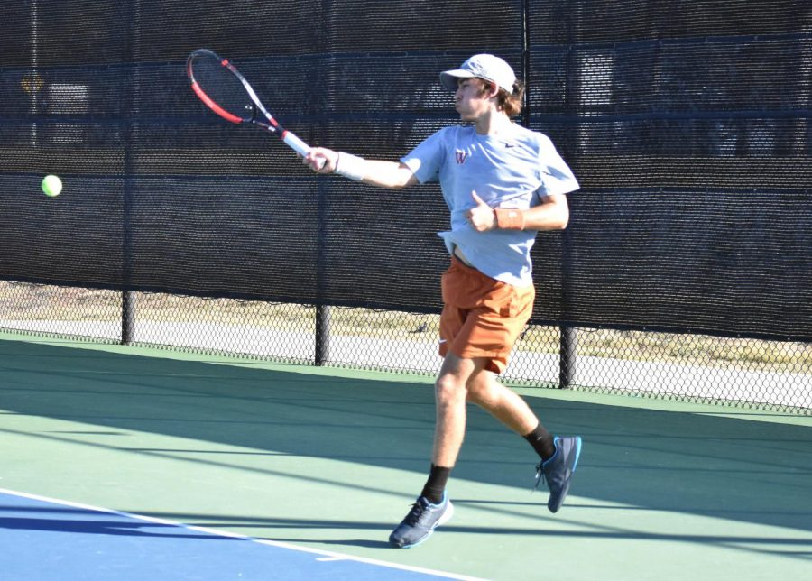 Driving through on a powerful forehand shot, Daniel Antov '21 leaps up to gain leverage. He would go on to take the first set of his singles match 6-1 before the Warriors secured a final 10-1 team victory.