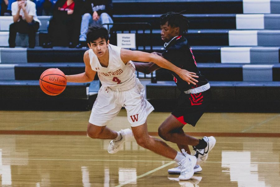 Darting away from his guard, Arjun Seth ('21) prepares to rush. He looks for any teammates to pass the ball to on his way to the basket.