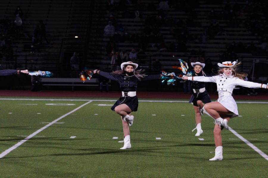 Dancing to Confident by Demi Lovato, SunDancers Faye Merritt '23 and Greta Mock '22 perform at halftime. This was the last halftime performance of the year.