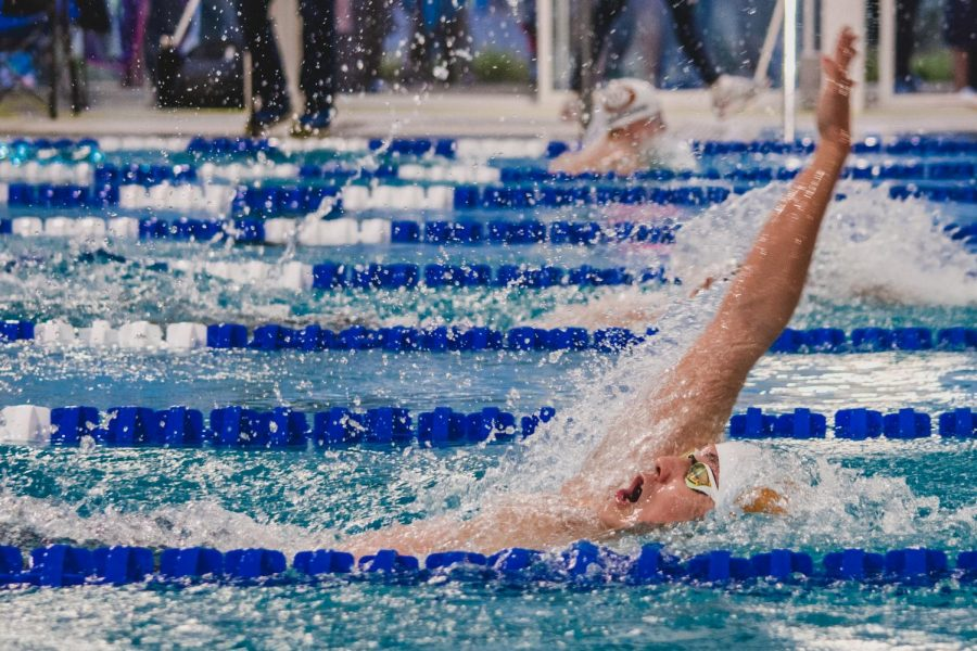 Dillon Shadowen '24 races to a secnd place finish in the 100yd backstroke. Shadowen was also the integral backstroke leg of the winning 4x50 medley relay.