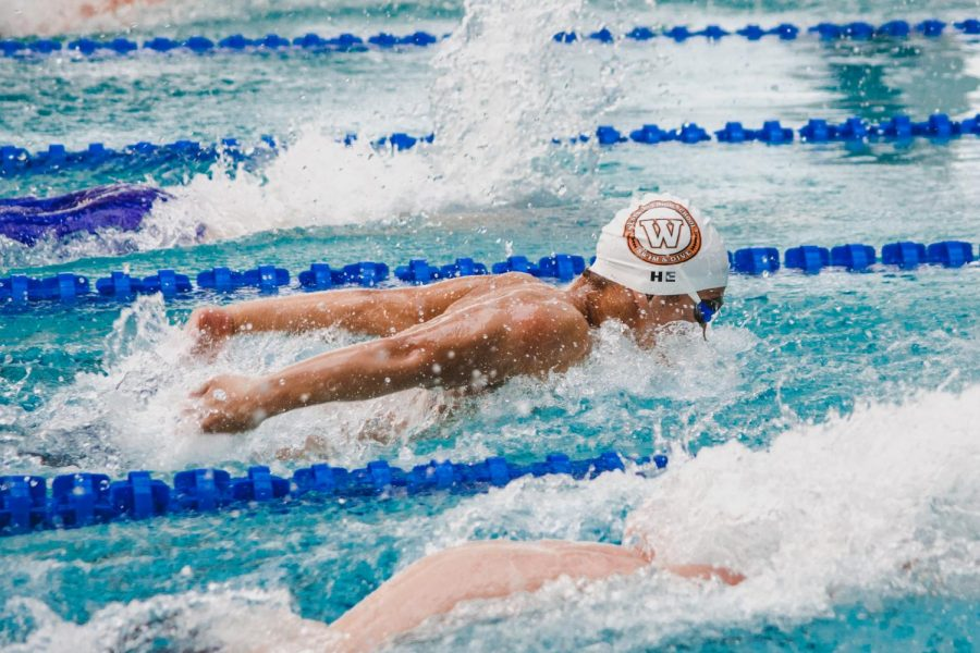 Shaving .32 seconds off of his high school best time, Benjamin He '23 finishes with a 56.81 100yd fly. He came in 12th overall in this event.