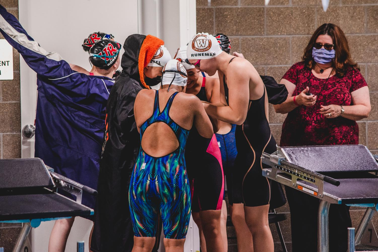 Swim+and+Dive+Teams+Star+at+District+Meet