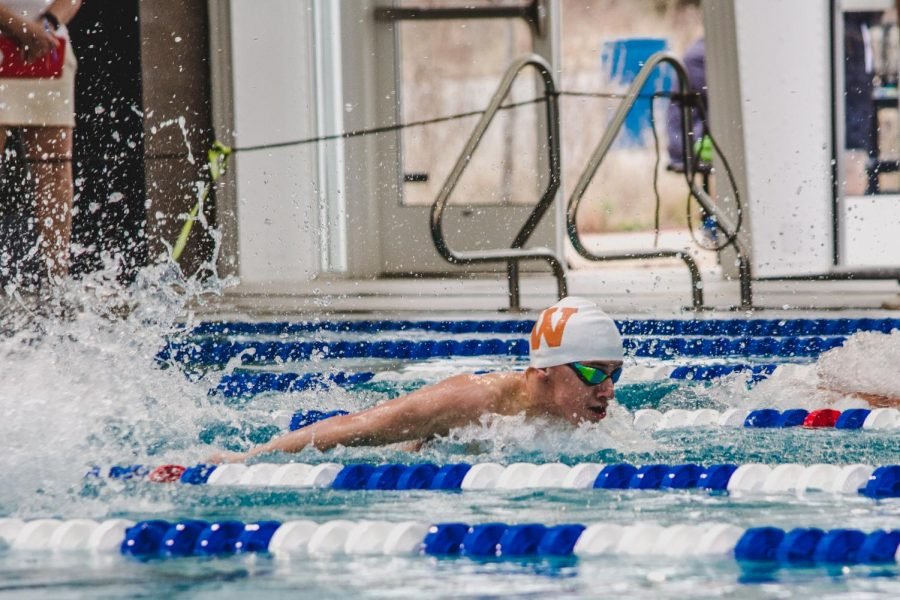 With a 52.92, Grady Radcliff '23 secures second in the 100yd fly. Radcliff's sprint fly also helped the Westwood 200yd medley relay secure first place.