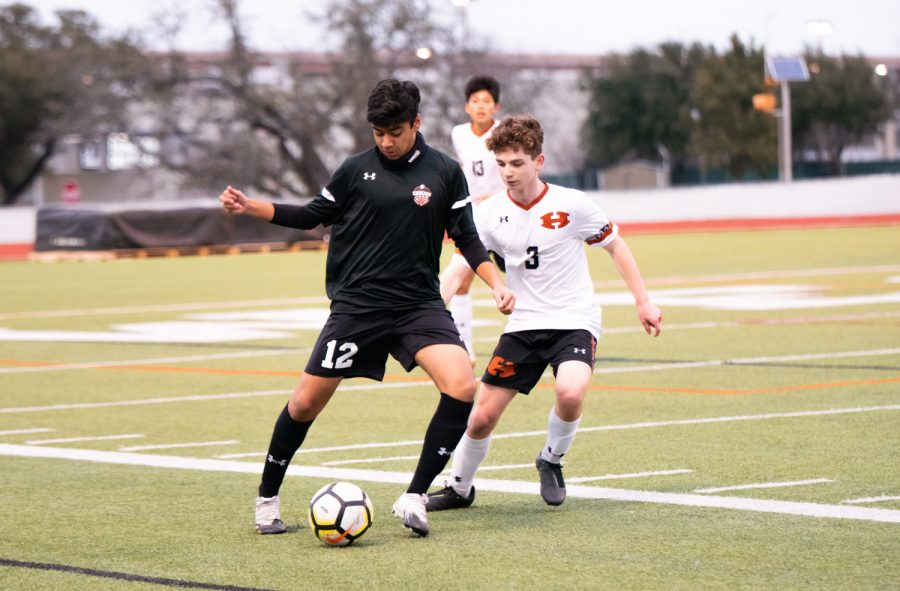 After receiving the ball, Neel Kakkad '24 focuses in to maintain possession of the ball as an opposing player comes in from his left. The Warriors would lose possession of the ball but would quickly regain it.