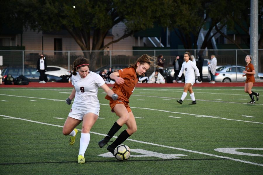 Kate Cooper '24 boxes out her defender to get the ball back into Westwood's control. After a short fight she snatches it back and continues the play.