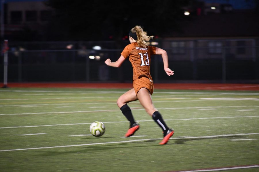 After a rough fight with Dripping Springs, Tayte Webster '23 makes a fast break down the field. The fast break leads to her first goal of the game.