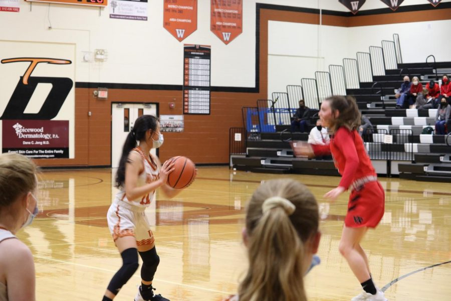 Olivia Yang '23 tries to block the defensive players on the Vista Ridge team. She then passed the ball to a fellow team member.