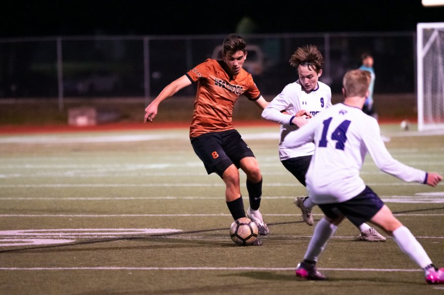 With an opposing player on his left side looking to take possession of the ball, Diego Djordjevic '22 dribbles the ball. Djordjevic would maintain possession and further advance the ball.