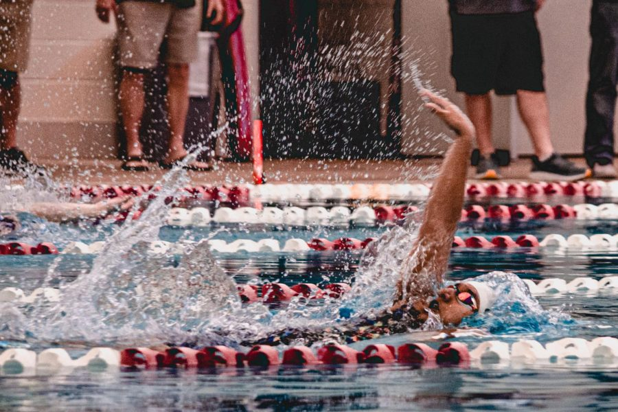 Shireen Gore '23 races the 100yd backstroke, swimming to a new best time of 59.51. Gore was also an important part of Westwoods first place 4x50yd medley relay.