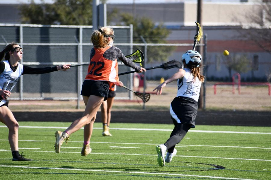 With a deadly swing of her stick, Sarah Poppe '22 whips a shot into the goal. This shot was a penalty shot, caused by a shooting space call on the opposing defense.