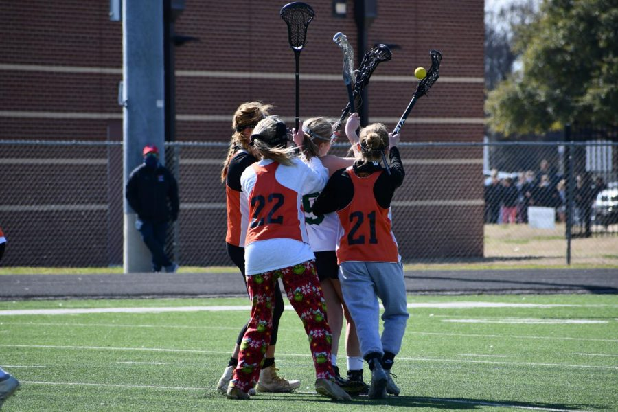 After the opposing team gains possession, Joy Yang '22, Sarah Poppe '22, and Bridgette Moravec '24 form a lethal triple team. This defensive move led to a recovery of the ball by Poppe.