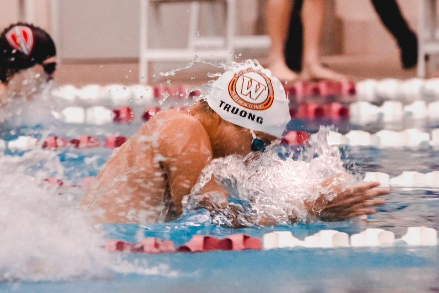 Benjamin Truong '21 wins the B-final in the 100-yard breaststroke. With a time of 59.68 seconds, he scored nine points for the men's team.