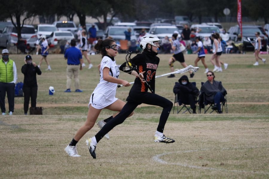 Emily Rose '24 runs towards the attackers after transitioning the ball to the other side of the field. After a few passes, the Vipers intercepted and got the ball.