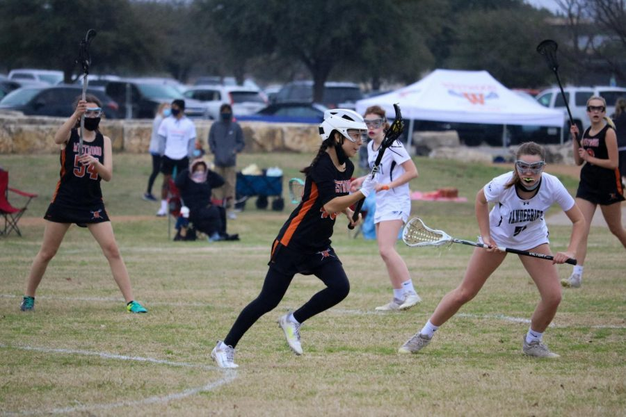 Anna Irmetova '23 dodges her defender to find a solid pass. Prior to this, she picked up a ground ball, giving Westwood possession.