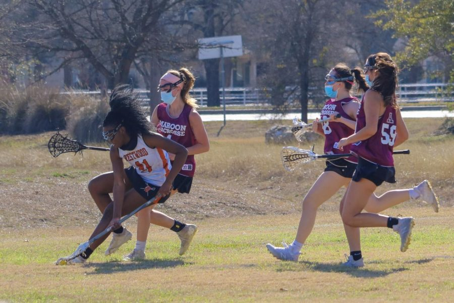 Kaybee Beggs '21 scoops up a ground ball before Austin reaches it. After picking it up, she passes the ball to the midfielders, transitioning it to attack.