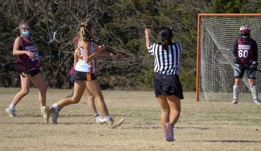 Sarah Poppe '22 cuts to the cage after running the ball down the field. With a clear lane, she scores a point for Westwood.