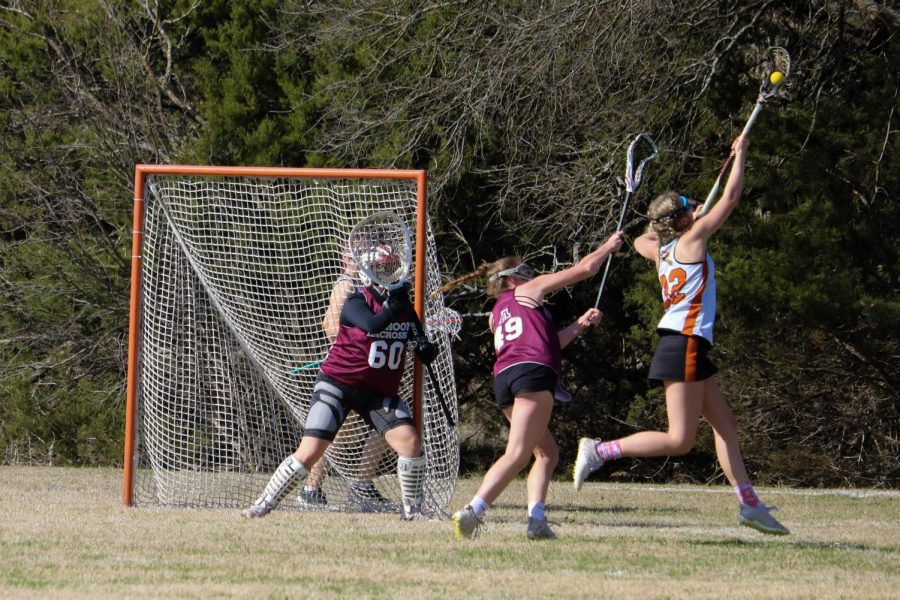 Laura Moravec '22 catches a pass made by a teammate. She made a cut in an open lane and was able to make a shot.